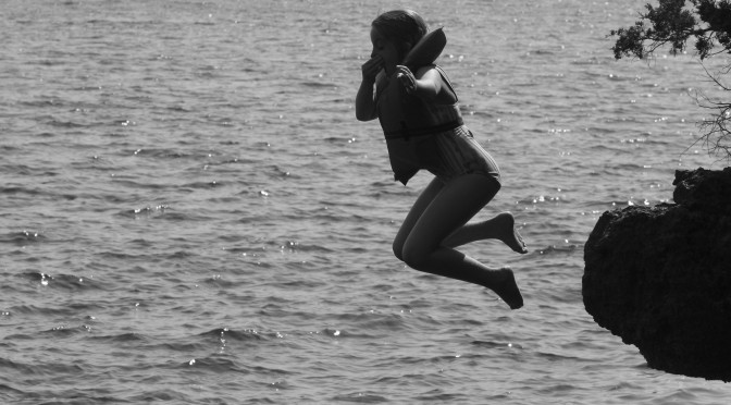 Flying Leap; photo of child jumping into water